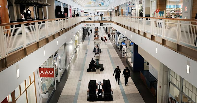 People walk through a nearly empty shopping mall in Waterbury, Connecticut.