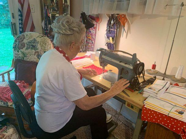 PHOTO: Krier works on masks made of the iconic red polka dot fabric 'Rosies' were famous for. (Mae Krier)