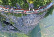 "<p>Visitors stroll across a glass skywalk nearly 1000 feet up, located on Panlong Cliff in China // August 1, 2016</p><p><strong>RELATED: </strong><a href=""https://www.redbookmag.com/life/news/g3773/best-travel-apps-trip-planner/"" rel=""nofollow noopener"" target=""_blank"" data-ylk=""slk:11 Apps That Take the Stress Out of Vacation Planning"" class=""link rapid-noclick-resp""><strong>11 Apps That Take the Stress Out of Vacation Planning</strong></a></p>"