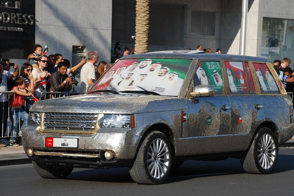 A car covered in what appears to be coins is part of the National Day parade held at Downtown Dubai. (Photo: Donna.M.Bee.Photography)