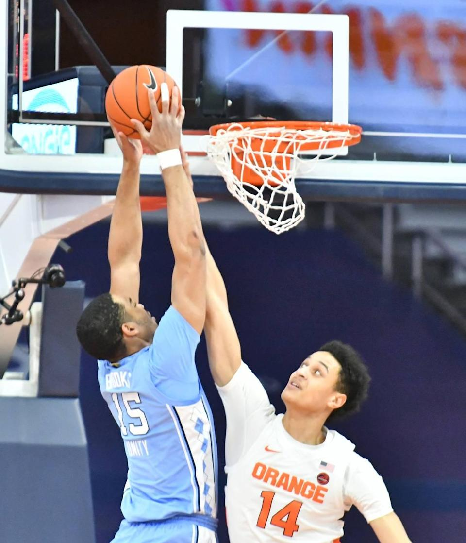North Carolina Tar Heels forward Garrison Brooks (15) dunks the ball as Syracuse Orange center Jesse Edwards (14) attempts to block the shot in the first half at the Carrier Dome.