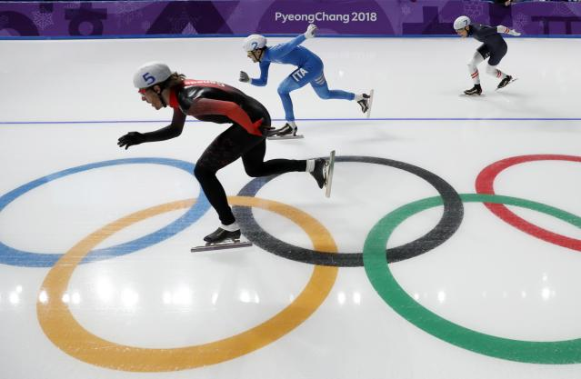 Speed Skating - Pyeongchang 2018 Winter Olympics - Men's Mass Start semifinal - Gangneung Oval - Gangneung, South Korea - February 24, 2018 - Olivier Jean of Canada, Andrea Giovannini of Italy and Linus Heidegger of Austria compete. REUTERS/Damir Sagolj