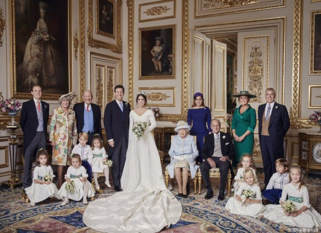 Prince George, Princess Charlotte, Queen Elizabeth, Prince Phillip, Maud Windsor, Louis De Givenchy, Theodora Williams, Mia Tindall, Isla Phillips, Savannah Phillips, Thomas Brooksbank, Nicola Brooksbank, George Brooksbank, Princess Beatrice, Sarah Ferguson, and Prince Andrew are pictured with Princess Eugenie and Jack Brooksbank in an official portrait.