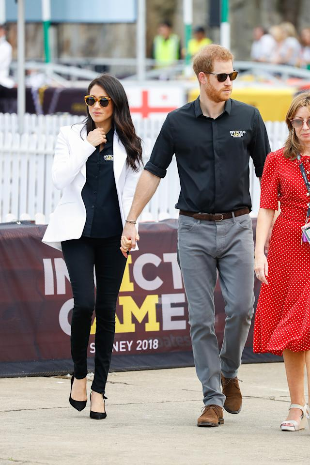<p>The 37-year-old wore an Invictus Games polo shirt with black jeans from Mother Denim ($275), a white blazer from Altuzzara ($2200) and the same Tabitha Simmons heels ($1000). Source: Getty </p>
