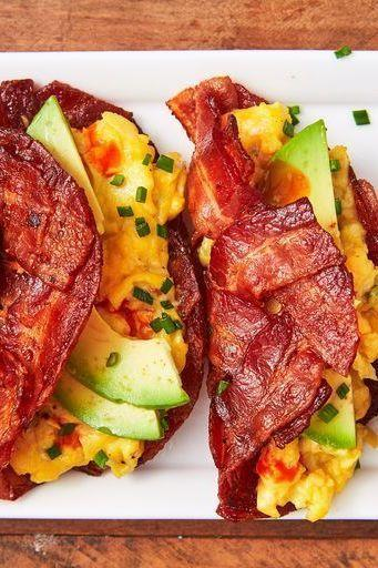 """<p>Nothing kickstarts your day like a high protein, low carb breakfast! We looove whipping up our <a href=""""https://www.delish.com/uk/cooking/recipes/a34939790/bacon-weave-breakfast-sandwich-recipe/"""" rel=""""nofollow noopener"""" target=""""_blank"""" data-ylk=""""slk:Bacon Weave Breakfast Sandwiches"""" class=""""link rapid-noclick-resp"""">Bacon Weave Breakfast Sandwiches</a> for a high-energy day, and this taco variation mixes it up in the best way possible. Top it with some <a href=""""https://www.delish.com/uk/cooking/a32570797/easy-homemade-salsa-recipe/"""" rel=""""nofollow noopener"""" target=""""_blank"""" data-ylk=""""slk:Homemade Salsa"""" class=""""link rapid-noclick-resp"""">Homemade Salsa</a> for a hearty and healthy breakfast that will keep you full well past the midmorning slump.</p><p>Get the <a href=""""https://www.delish.com/uk/cooking/recipes/a34939698/bacon-weave-breakfast-tacos/"""" rel=""""nofollow noopener"""" target=""""_blank"""" data-ylk=""""slk:Bacon Weave Breakfast Tacos"""" class=""""link rapid-noclick-resp"""">Bacon Weave Breakfast Tacos</a> recipe.</p>"""
