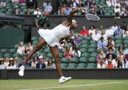 Coco Gauff of the US serves to Russia's Elena Vesnina during the women's singles second round match on day four of the Wimbledon Tennis Championships in London, Thursday July 1, 2021. (AP Photo/Alberto Pezzali)
