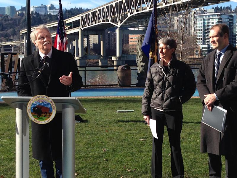 Oregon, Governor John Kitzhaber, left, announces Wednesday Feb. 5, 2014, plans to develop the West Coast's first offshore wind energy farm, as U.S. Secretary of the Interior Sally Jewell, center, and Bureau of Ocean Energy Management Director Tommy Beaudreau look on in Portland, Ore. The pilot project will be developed by Seattle-based Principle Power using floating wind turbine technology that has not been deployed in U.S. waters but is in use or under development in Europe and Asia. (AP Photo/Gosia Wozniacka)