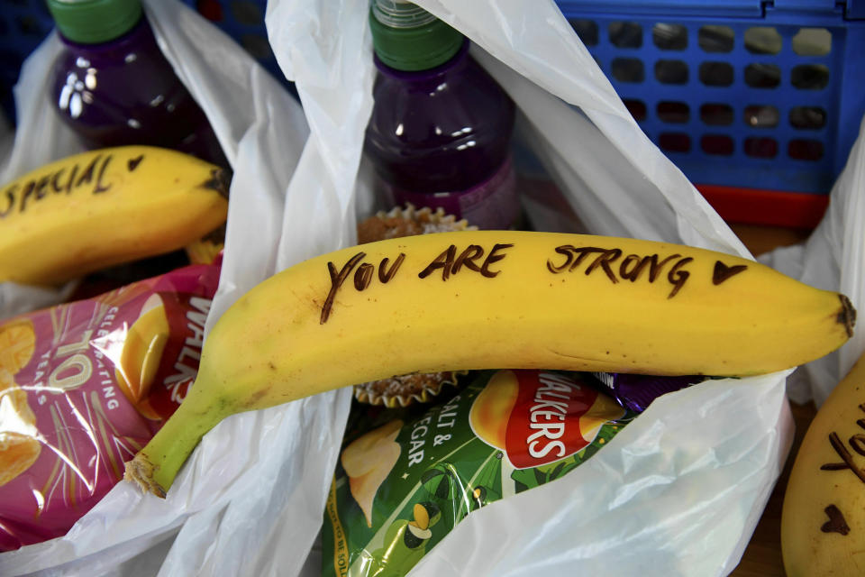 Messages written on bananas by Meghan, the Duchess of Sussex as she helped to prepare food parcels to be dispatched by the charity outreach van, during her visit with Britain's Prince Harry to One25, a charity specialising in helping women to break free from street sex work, addiction and other life-controlling issues. (Photo: Getty Images)