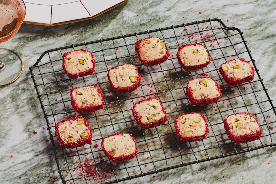 "A coating of crushed, freeze-dried raspberries and sanding sugar adds firework-like sparkle and crunch to these festive cookies. The dough benefits from an overnight rest in the fridge. <a href=""https://www.epicurious.com/recipes/food/views/pistachio-rose-shortbread-squares?mbid=synd_yahoo_rss"" rel=""nofollow noopener"" target=""_blank"" data-ylk=""slk:See recipe."" class=""link rapid-noclick-resp"">See recipe.</a>"