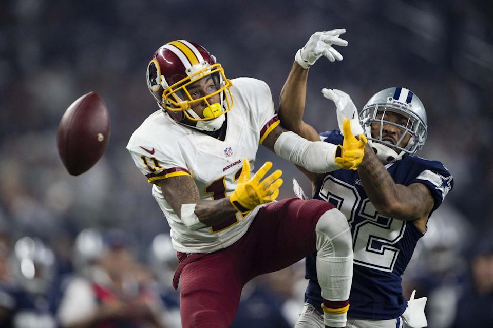 <p>Dallas Cowboys cornerback Orlando Scandrick (32) breaks up a pas intended for Washington Redskins wide receiver DeSean Jackson (11) during the second half at AT&T Stadium. Mandatory Credit: Jerome Miron-USA TODAY Sports </p>