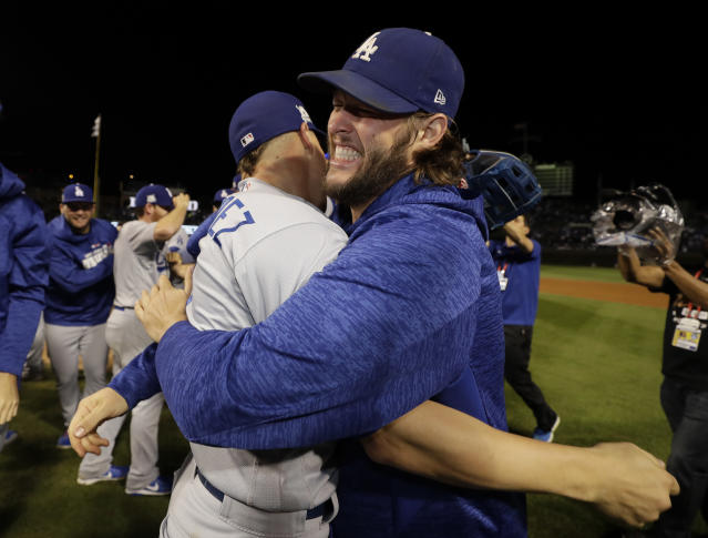 Enrique Hernandez and Clayton Kershaw celebrate after Game 5 of the NLCS to advance to the World Series. (AP)