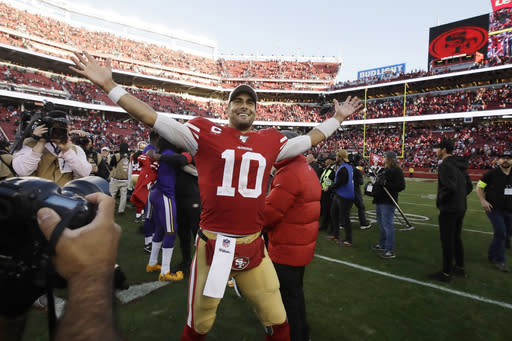 San Francisco 49ers quarterback Jimmy Garoppolo (10) celebrates after the 49ers beat the Minnesota Vikings 27-10 in an NFL divisional playoff football game, Saturday, Jan. 11, 2020, in Santa Clara, Calif. (AP Photo/Ben Margot)