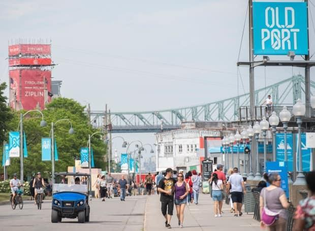 In the second half of the summer, an all-circus entertainment program is slated to hit the Old Port to relaunch the area and attract much-needed tourists.  (Graham Hughes/The Canadian Press - image credit)