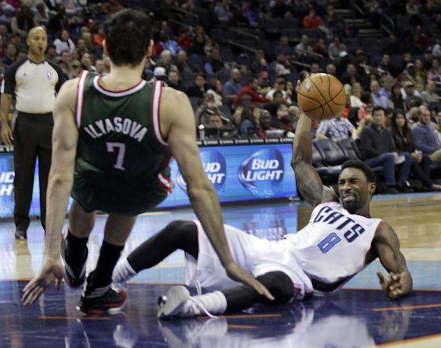 Charlotte Bobcats' Ben Gordon (8) looks to pass after being knocked down by Milwaukee Bucks' Ersan Ilyasova (7) during the first half of an NBA basketball game in Charlotte, N.C., Friday, Nov. 29, 2013. (AP Photo/Chuck Burton)