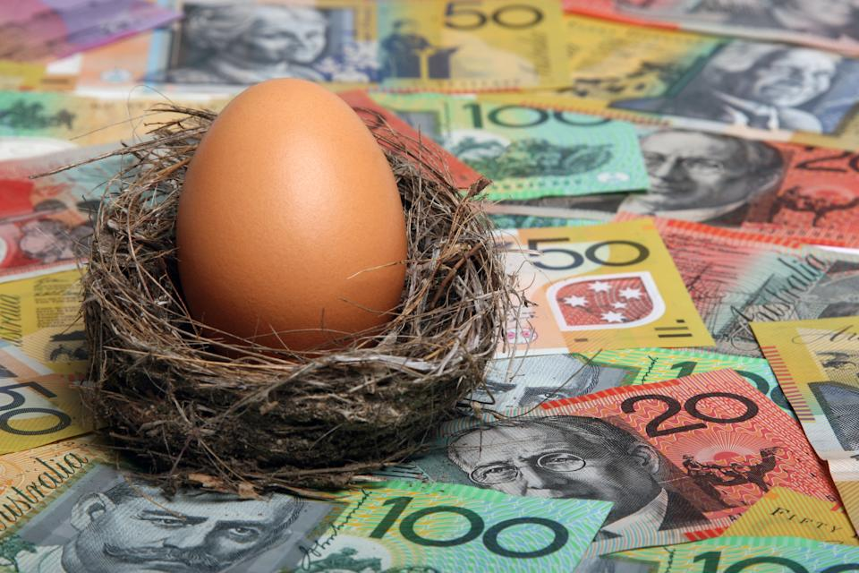Savings nest egg with Australian dollar notes aa focus on egg. Click to see more...
