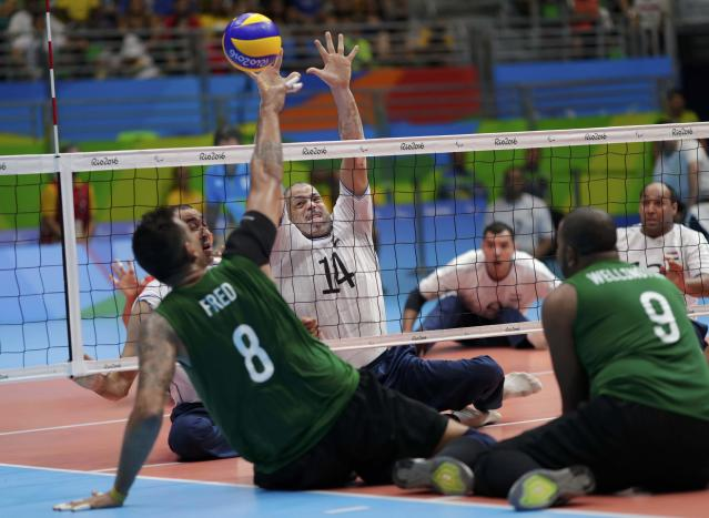 2016 Rio Paralympics - Sitting Volleyball - Men's Bronze Medal Match - Riocentro Pavilion 6 - Rio de Janeiro, Brazil - 18/09/2016. Frederico Doria de Souza (BRA) of Brazil and Metawa Abouelkhir (EGY) of Egypt in action. REUTERS/Ueslei Marcelino FOR EDITORIAL USE ONLY. NOT FOR SALE FOR MARKETING OR ADVERTISING CAMPAIGNS.