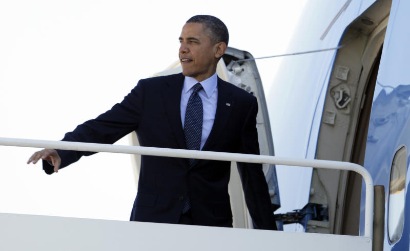 President Barack Obama boards Air Force One, Friday, April 13, 2012, at Andrews Air Force Base, Md., en route to Florida. (AP Photo/Carolyn Kaster)