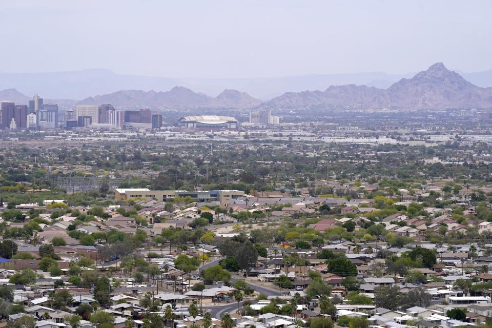 Even with the population increase in Arizona being among one of the fastest-growing states during the last decade, its 7.1 million population, especially in the Phoenix area shown here, the increase was not enough to give the state a 10th congressional seat announced by the Census Bureau Monday, April 26, 2021. (AP Photo/Ross D. Franklin)