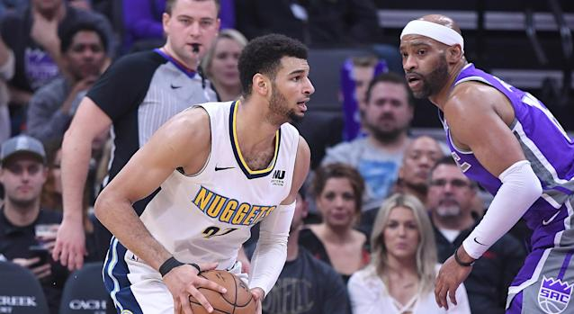 Jamal Murray and Vince Carter battle during a regular season game between the Denver Nuggets and Sacramento Kings in 2018. (Photo by Thearon W. Henderson/Getty Images)