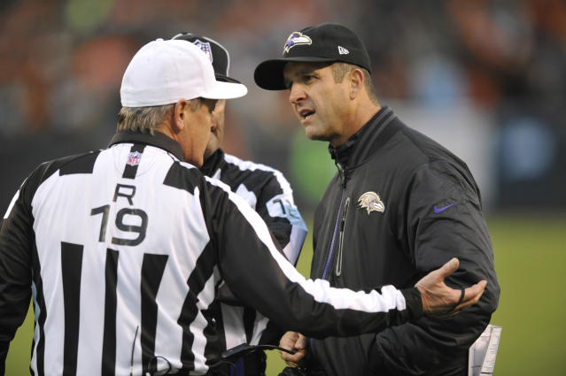Baltimore Ravens head coach John Harbaugh, right, discusses a call with referee Scott Green (19) in the second quarter of an NFL football game against the Cleveland Browns Sunday, Nov. 3, 2013. (AP Photo/David Richard)