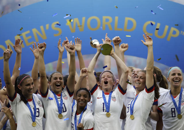 United States' Megan Rapinoe lifts up a trophy after winning the Women's World Cup final against The Netherlands. (AP)