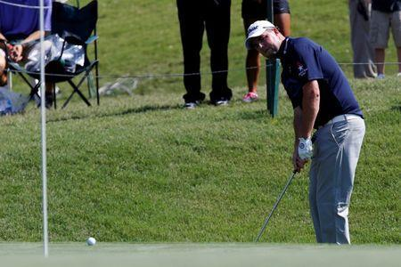 May 8, 2014; Ponte Vedra Beach, FL, USA; Marc Leishman chips up to the 9th green during the first round of The Players Championship at TPC Sawgrass - Stadium Course. Mandatory Credit: Geoff Burke-USA TODAY Sports