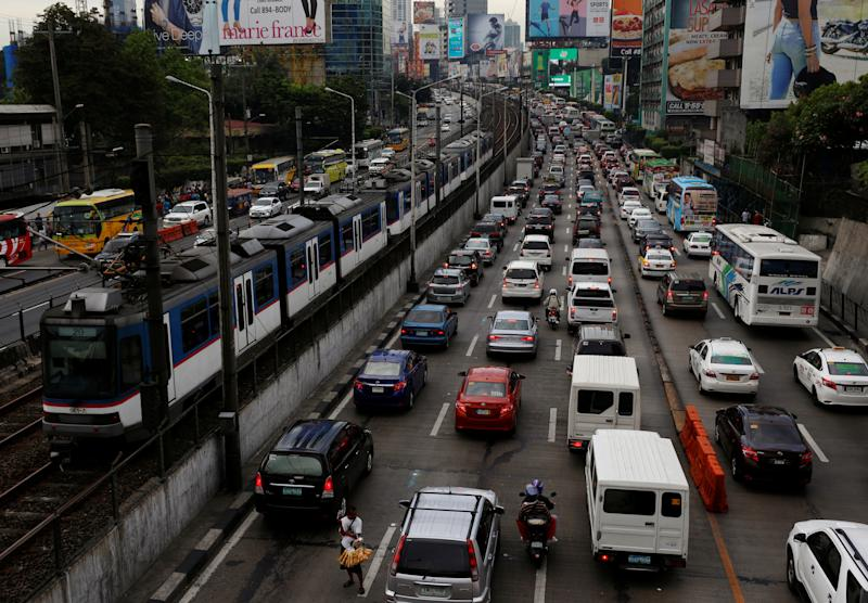 File Photo: Motorists drive through a heavy traffic flow during rush hours along the main highway EDSA in Makati, Metro Manila, Philippines. REUTERS/Erik De Castro
