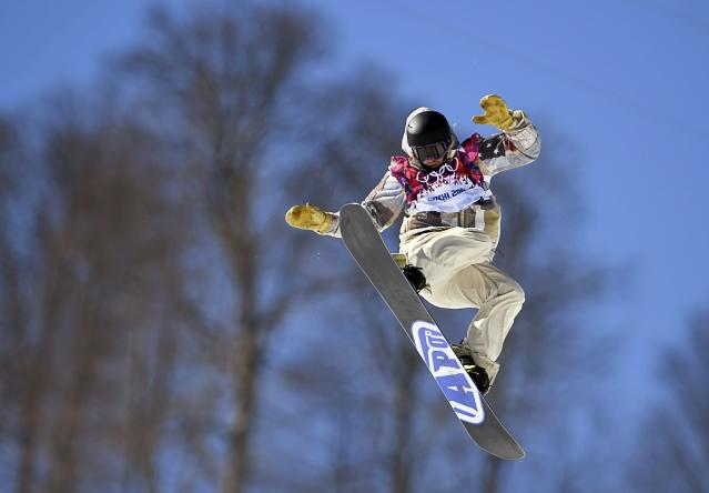 Sage Kotsenburg of the U.S. performs a jump during the men's snowboard slopestyle final at the 2014 Sochi Olympic Games in Rosa Khutor February 8, 2014. REUTERS/Dylan Martinez (RUSSIA - Tags: OLYMPICS SPORT SNOWBOARDING)