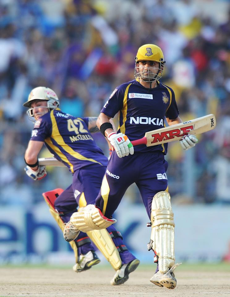 Kolkata Knight Riders batsman Gautam Gambhir (R) and Brendon McCullum run between wickets during the IPL Twenty20 cricket match between Kolkata Knight Riders and Pune Warriors India at The Eden Gardens in Kolkata on May 5, 2012.  RESTRICTED TO EDITORIAL USE. MOBILE USE WITHIN NEWS PACKAGE.  AFP PHOTO/Dibyangshu SARKAR        (Photo credit should read DIBYANGSHU SARKAR/AFP/GettyImages)