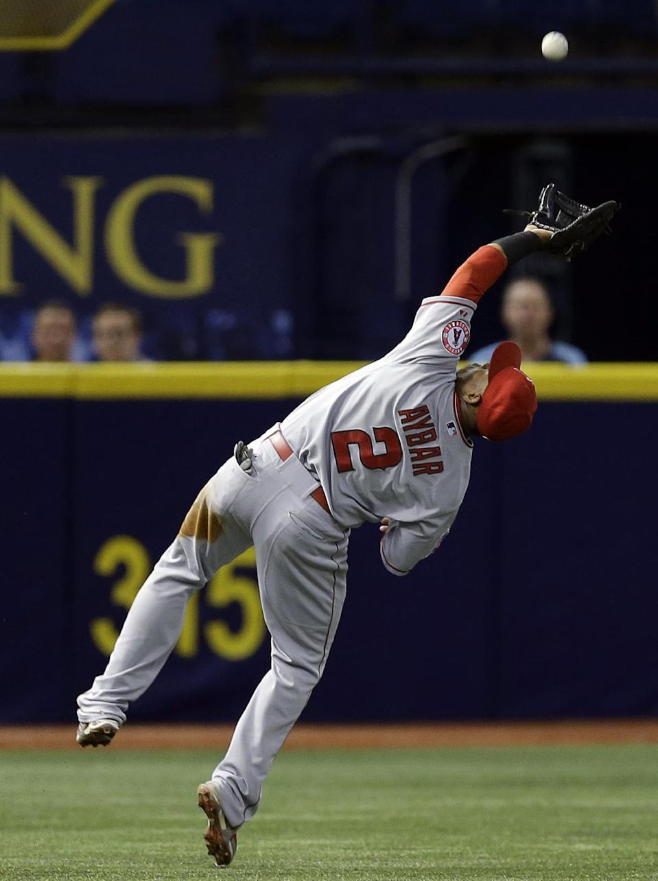 Los Angeles Angels shortstop Erick Aybar makes an off balance catch on a pop out by Tampa Bay Rays' Kevin Kiermaier during the fourth inning of a baseball game Tuesday, June 9, 2015, in St. Petersburg, Fla. (AP Photo/Chris O'Meara)