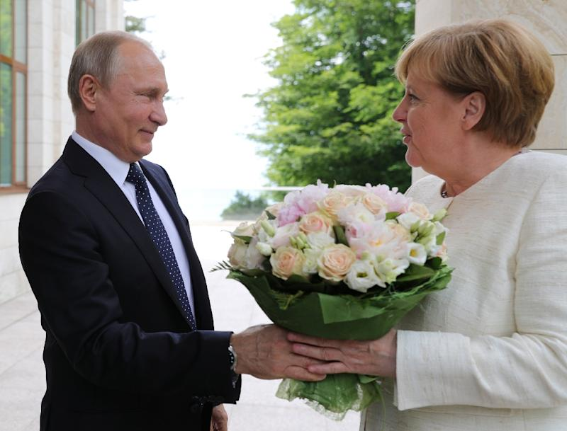 Russian President Vladimir Putin (L) and German Chancellor Angela Merkel met in Sochi and put on a rare show of unity over the Nord Stream 2 pipeline and the Iran nuclear deal