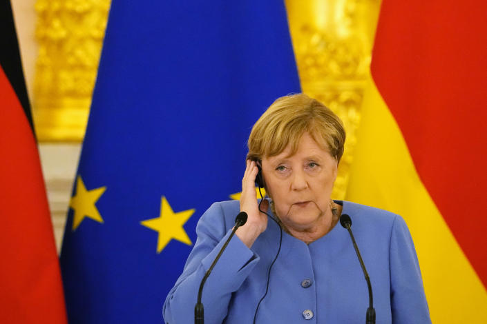 German Chancellor Angela Merkel attends a joint news conference with Russian President Vladimir Putin following their talks in the Kremlin in Moscow, Russia, Friday, Aug. 20, 2021. The talks between Merkel and Putin are expected to focus on Afghanistan, the Ukrainian crisis and the situation in Belarus among other issues. (AP Photo/Alexander Zemlianichenko, Pool)