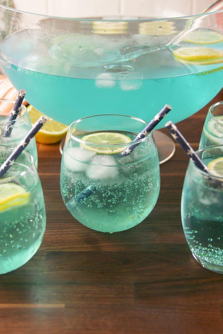 """<p>You'll want to have this yummy punch on hand when your team scores (and hopefully wins!). It's made with Sprite, seltzer, prosecco, vodka, and blue Curaçao. </p><p><em><a href=""""https://www.delish.com/cooking/recipe-ideas/recipes/a57661/touchdown-punch-recipe/"""" rel=""""nofollow noopener"""" target=""""_blank"""" data-ylk=""""slk:Get the recipe from Delish »"""" class=""""link rapid-noclick-resp"""">Get the recipe from Delish »</a></em></p>"""