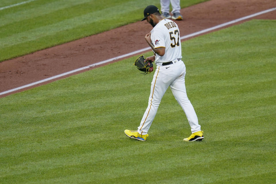Pittsburgh Pirates starting pitcher Luis Oviedo heads to the dugout after being removed in the second inning of the team's baseball game against the Milwaukee Brewer on Tuesday, July 27, 2021, in Pittsburgh. (AP Photo/Keith Srakocic)