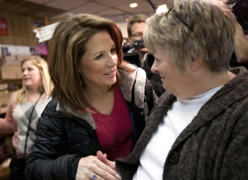 Republican Presidential candidate, Rep. Michele Bachmann, R-Minn. meets with patrons at the Nodaway Diner during a campaign stop, Wednesday, Dec. 28, 2011, in Greenfield, Iowa.  (AP Photo/Evan Vucci)