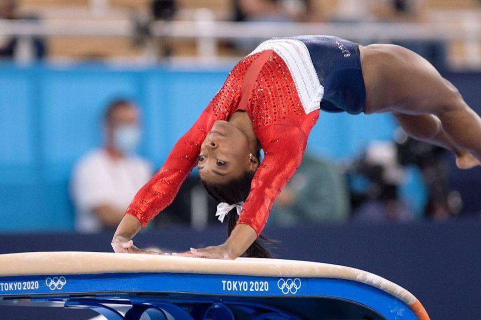<p>USA gymnastics star Simone Biles competes at the women's team final. Biles ended up dropping out of the Olympic final because she was not in a good place mentally to compete.</p>