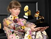 "Taylor Swift became the first woman to win the coveted Album of the Year prize three times, for the first of her twin quarantine albums, ""folklore"""