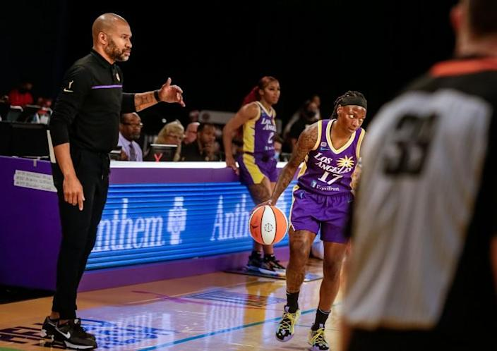 LOS ANGELES, CA. - JUNE 30: Derek Fisher, Head Coach of the Sparks, watches as point guard Erica Wheeler runs the play he drew up against the Las Vegas Aces at the Los Angeles Convention Center on Wednesday, June 30, 2021 in Los Angeles, CA. (Jason Armond / Los Angeles Times)