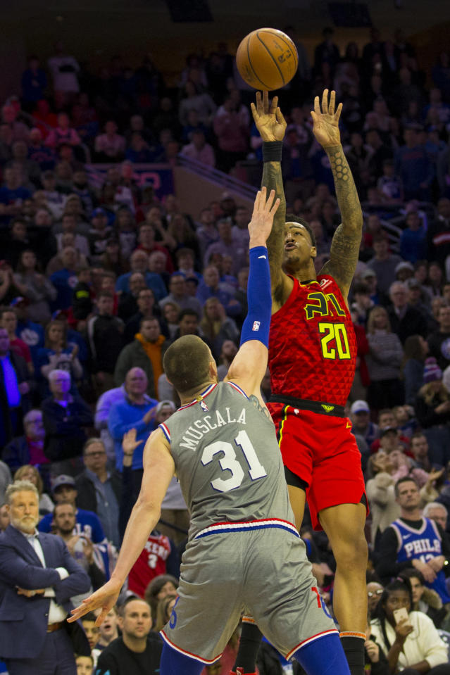 PHILADELPHIA, PA - JANUARY 11: John Collins #20 of the Atlanta Hawks makes the game winning basket against Mike Muscala #31 of the Philadelphia 76ers in the final seconds of the game at the Wells Fargo Center on January 11, 2019 in Philadelphia, Pennsylvania. The Hawks defeated the 76ers 123-121. (Photo by Mitchell Leff/Getty Images)