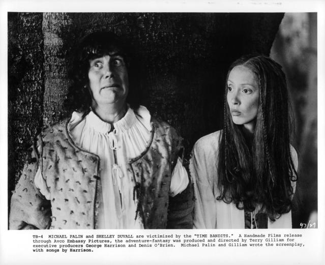 Michael Palin and Shelley Duvall look to their right in a scene from the film 'Time Bandits', 1981. (Photo by AVCO Embassy Pictures/Getty Images)