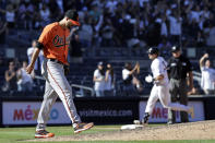 Baltimore Orioles pitcher Jorge Lopez, left, reacts after giving up a two-run home run to New York Yankees' Joey Gallo during the eighth inning of a baseball game on Saturday, Sept. 4, 2021, in New York. (AP Photo/Adam Hunger)