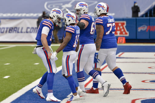 Buffalo Bills quarterback Josh Allen, left, celebrates a touchdown by wide receiver Isaiah McKenzie (19) in the first half of an NFL football game against the Miami Dolphins, Sunday, Jan. 3, 2021, in Orchard Park, N.Y. (AP Photo/Adrian Kraus )