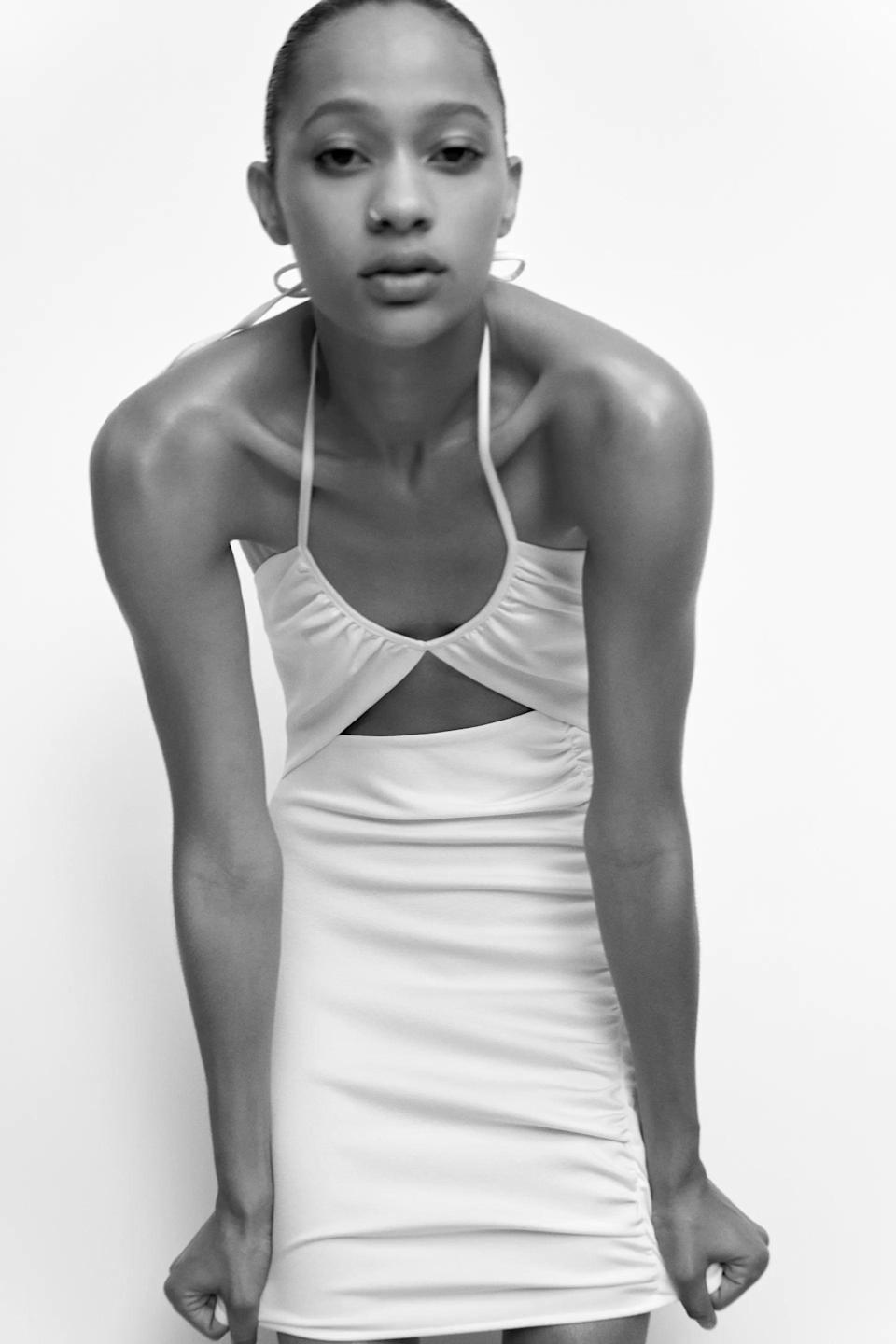 <p>Halter necks are back and better than ever. We like this white <span>Zara Cutout Mini Dress</span> ($46).</p>