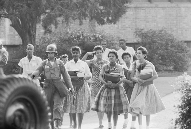 Members of the Little Rock Nine leave Central High School at the end of a school day.