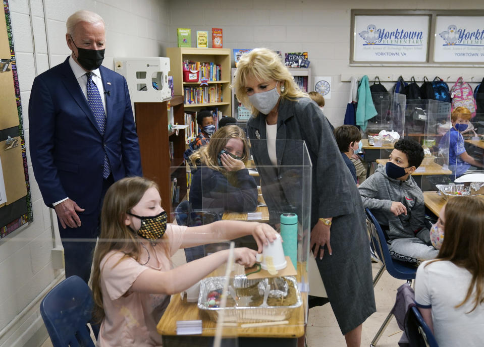 President Joe Biden and first lady Jill Biden, watch a student demonstrate her project, during a visit to Yorktown Elementary School, Monday, May 3, 2021, in Yorktown, Va. (AP Photo/Evan Vucci)