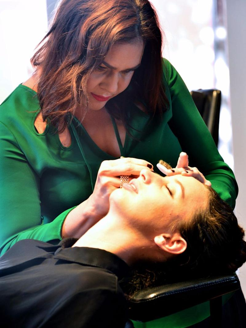 Sharon Lee tending to a client's brows. Source: Supplied