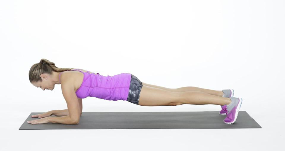 <ul> <li>Start on the floor, resting on your forearms and knees.</li> <li>Step your feet out one at a time, coming into a plank position.</li> <li>Contract your abs to prevent your booty from sticking up or sinking. Your spine should be parallel to the floor, with your abs pulling toward the ceiling.</li> <li>Hold for 30 seconds, and work your way up to one minute as you get stronger. This counts as one rep.</li> </ul>