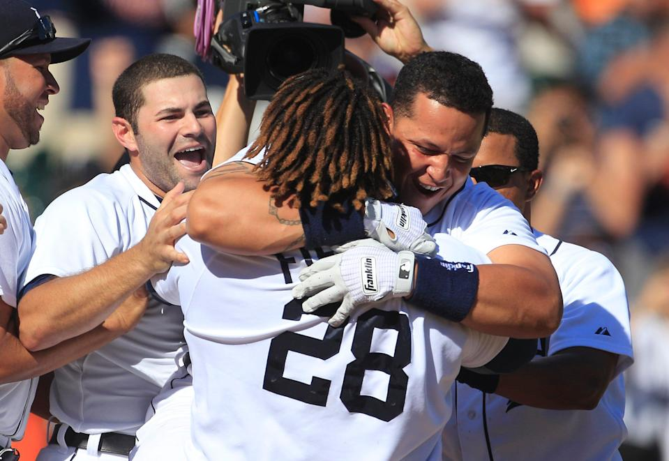 Miguel Cabrera hugs Prince Fielder (28) after hitting a home run off Cleveland pitcher Chris Perez during the 10th inning in Detroit on Sunday, Aug. 5, 2012.
