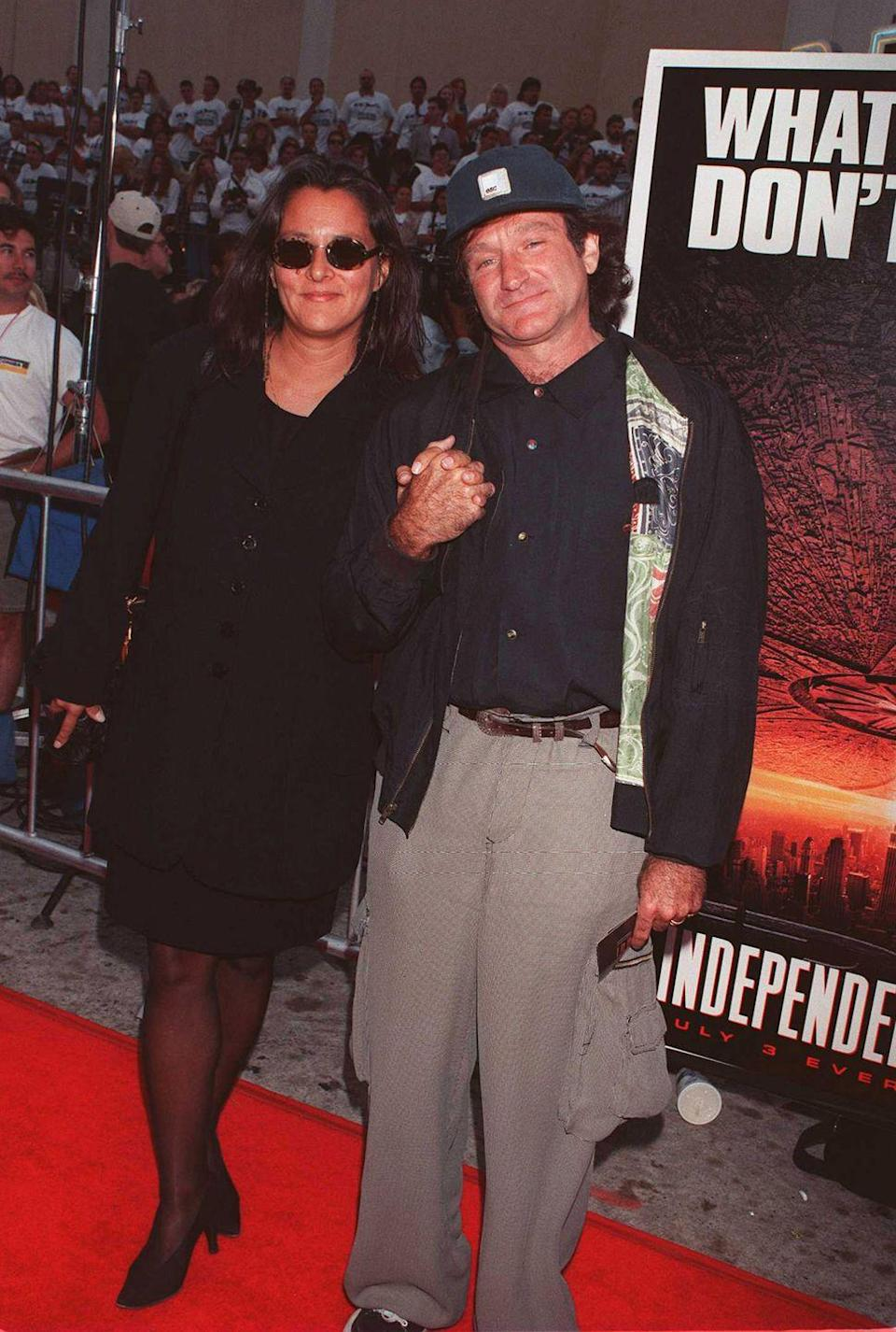 <p>Robin Williams with his wife, Marsha Garces. </p>