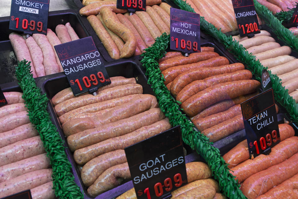 Rows of sausages in a butcher's shop including kangaroo sausages.